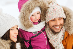 Happy family with child in winter clothes outdoors Stock Photo