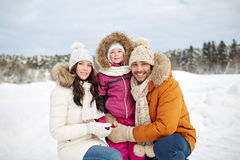 Happy family with child in winter clothes outdoors Stock Image