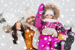 Happy family with child in winter clothes outdoors Stock Images