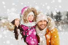 Happy family with child in winter clothes outdoors Royalty Free Stock Photos