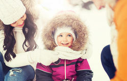 Happy family with child in winter clothes outdoors Royalty Free Stock Photo