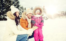 Happy family with child in winter clothes outdoors Royalty Free Stock Photography