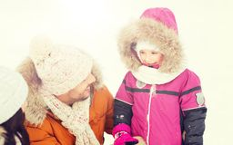 Happy family with child in winter clothes outdoors Stock Photography