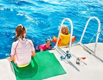 Happy family with child on yacht. Stock Photos