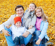 Happy family with children in autumn park Stock Photo