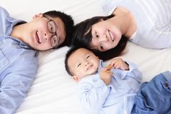 Happy family with children in bed Royalty Free Stock Photo