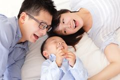 Happy family with children in bed Stock Photography