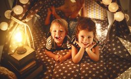 Happy family children brother and sister play, laugh and hug   i Stock Image