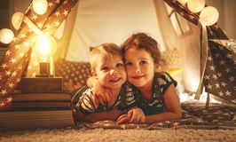Happy family children brother and sister play, laugh and hug   i Stock Photo
