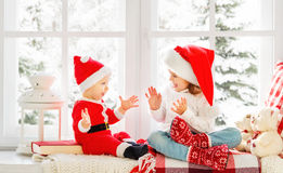 Happy family children brother and sister  on winter window Chris Royalty Free Stock Photography