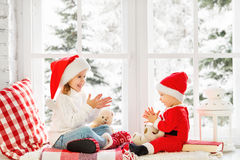 Happy family children brother and sister  on winter window Chris Royalty Free Stock Image