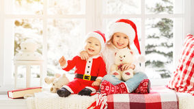Happy family children brother and sister  on winter window Chris Stock Images