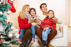 Happy family with children at christmas eve. At home in the living room stock photography