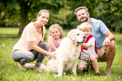 Happy family with children and dog Stock Photos