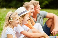 Happy family and children on a meadow royalty free stock photos