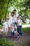 Happy family and  children in park. Royalty Free Stock Photography