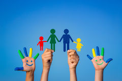 Happy family. Children with smiley on hands against blue summer sky background Stock Photography