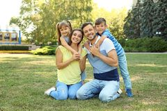 Happy family with children spending time together. In green park on sunny day royalty free stock image