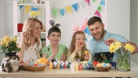 Happy family with children talking on Skype with relatives for Easter stock footage
