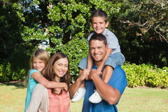 Happy family with children on their shoulders Stock Images