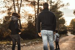Happy family with children walking through a forest . Family concept in nature stock images