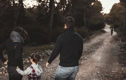 Happy family with children walking through a forest . Family concept in nature stock image