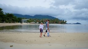 Happy family with children walks along the beach. Happy family walks along the beach stock footage