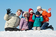Happy family with children in winter. Young smiling happy family with three children at winter snow outdoors stock images