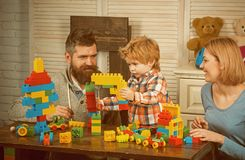 Happy family and childrens day. Little boy with dad and mom. happy childhood. Care and development. little boy play with. Parents at home. father and mother royalty free stock image