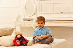Happy family and childrens day. little boy play at home. happy childhood. Care and development. child play toys. Little royalty free stock image
