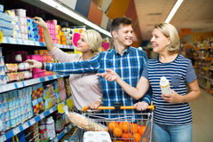 Happy family choosing dairy products and smiling Royalty Free Stock Photo