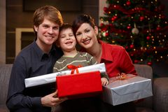 Happy family at christmas. Portrait happy family at christmas, holding presents, smiling Royalty Free Stock Image