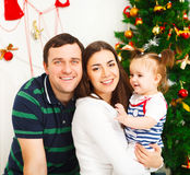Happy family with Christmas baby near the Christmas tree Royalty Free Stock Photography