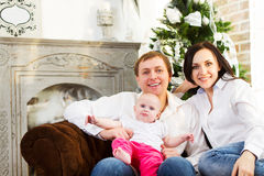 Happy family with Christmas baby near the Christmas tree Royalty Free Stock Images