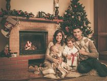 Happy family in Christmas decorated house Stock Photography