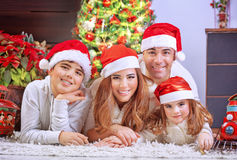 Happy family in Christmas eve Royalty Free Stock Photography