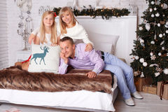 Happy family on Christmas Eve Royalty Free Stock Photo