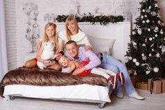 Happy family on Christmas Eve Royalty Free Stock Images