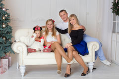 Happy family on Christmas Eve Royalty Free Stock Photos