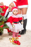 Happy family in Christmas eve at home sitting near Royalty Free Stock Photography