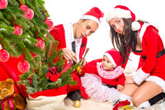 Happy family in Christmas eve at home sitting near Royalty Free Stock Images