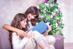 Happy family in Christmas eve Stock Photos