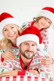 Happy family in Christmas eve stock photos
