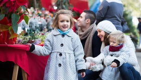 Happy family in Christmas fair Stock Image