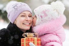 Happy family with Christmas gift Royalty Free Stock Image