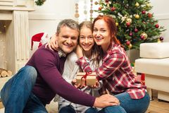 Happy family with christmas gift Stock Image