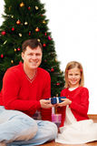 Happy family with Christmas gift. Portrait of happy family with Christmas gift Royalty Free Stock Image