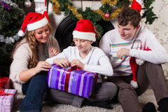 Happy family with Christmas gifts. Stock Image