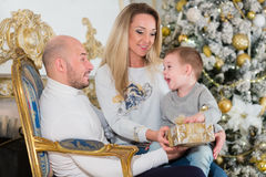 Happy family with Christmas gifts. Stock Photos