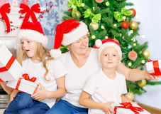 Happy family with Christmas gifts Royalty Free Stock Images